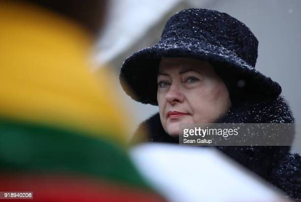 Lithuanian President Dalia Grybauskaite attends a ceremony at Rasos Cemetery to mark the 100th anniversary of the restoration of Lithuanian statehood...