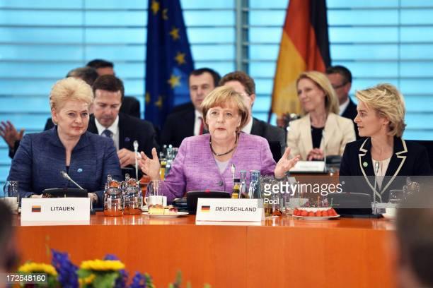 Lithuanian President Dalia Grybauskaite German Chancellor Angela Merkel and German Minister of Work and Social Issues Ursula von der Leyen attend a...