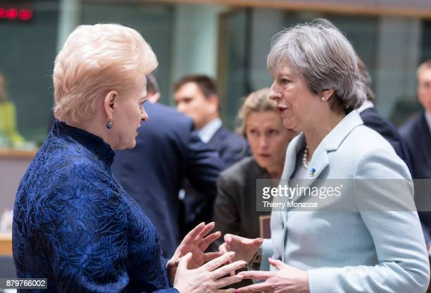 Lithuanian President Dalia Grybauskaite is talking with the Prime Minister of the United Kingdom Theresa May prior an EUEastern partnership summit on...