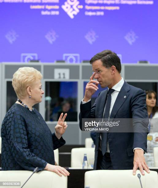 Lithuanian President Dalia Grybauskaite speaks with Dutch Prime Minister Mark Rutte during a round table meeting of EU and Western Balkan heads of...