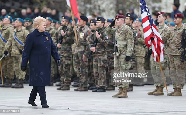 Lithuanian President Dalia Grybauskaite walks past soldiers of the US 173rd Airborne Brigade participating in a gathering and parade in the city...