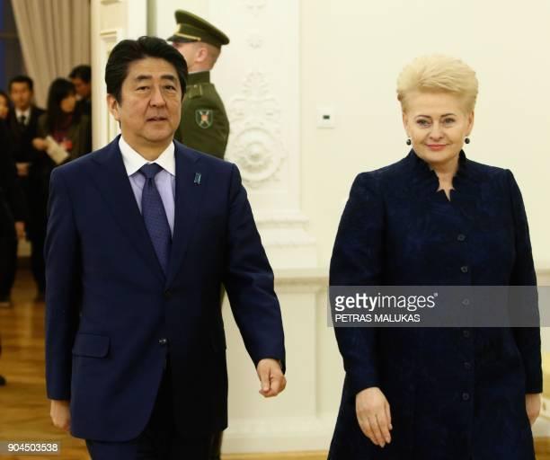 Lithuanian President Dalia Grybauskaite welcomes Japanese Prime Minister Shinzo Abe for talks in Vilnius on January 13 2018 / AFP PHOTO / Petras...