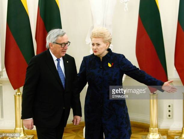 Lithuanian President Dalia Grybauskaite welcomes President of the European Commission JeanClaude Juncker upon his arrival for a ceremony marking 100...