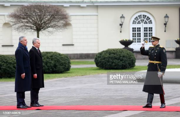 Lithuanian President Gitanas Nauseda and his counterpart from Montenegro Milo Dukanovic inspect a military honor guard during a welcoming ceremony at...