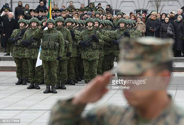 Lithuanian soldiers and one US soldier stand at attention prior to a parade in the city center during the Iron Sword multinational military exercises...