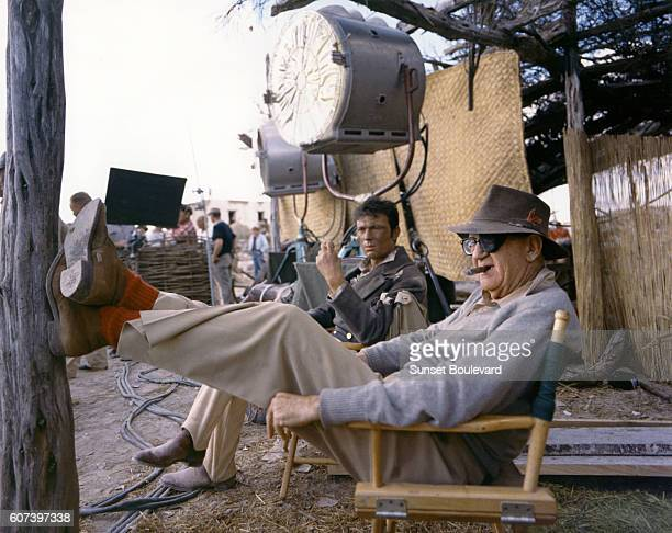Lithuanianborn actor Laurence Harvey and American actor John Ford on the set of The Alamo directed by John Wayne