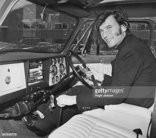 Lithuanianborn actor Laurence Harvey at the wheel of his brand new Wood Pickett Margrave Mini Cooper S completed to his specifications UK 15th July...