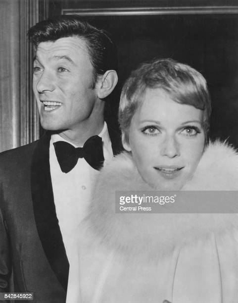Lithuanianborn actor Laurence Harvey with actress Mia Farrow at the premiere of the James Bond film 'Casino Royale' at the Odeon Leicester Square...