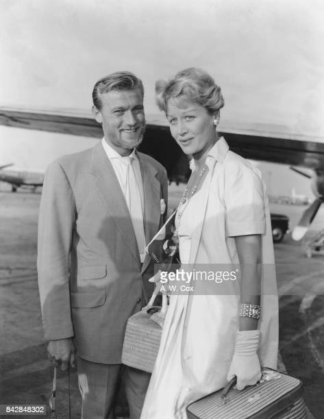 Lithuanianborn actor Laurence Harvey with his new wife English actress Margaret Leighton at London Airport 31st August 1957