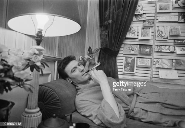 Lithuanianborn South Africanraised actor Laurence Harvey relaxing in a dressing room London UK 6th January 1965