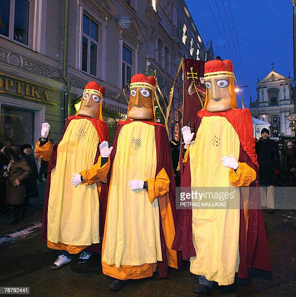 Lithuanians dressed up as kings prepare for a procession to celebrate Three Kings day 06 January 2007 in Vilnius' old city The Kings congratulate and...