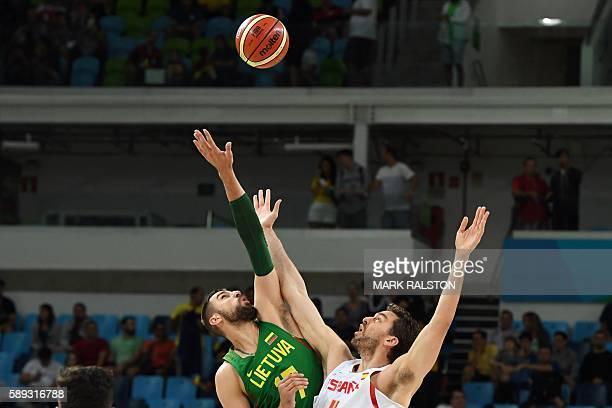 TOPSHOT Lithuania's centre Jonas Valanciunas and Spain's centre Pau Gasol jump at the start of a Men's round Group B basketball match between Spain...