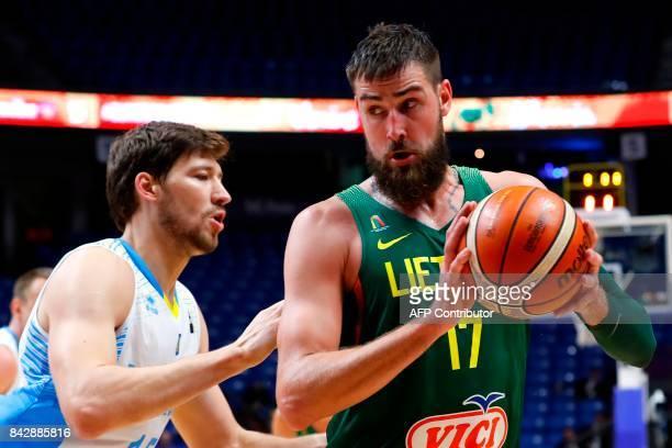 Lithuania's centre Jonas Valanciunas holds the ball as Ukraine's centre Viacheslav Kravtsov defends during the FIBA EuroBasket 2017 championship...