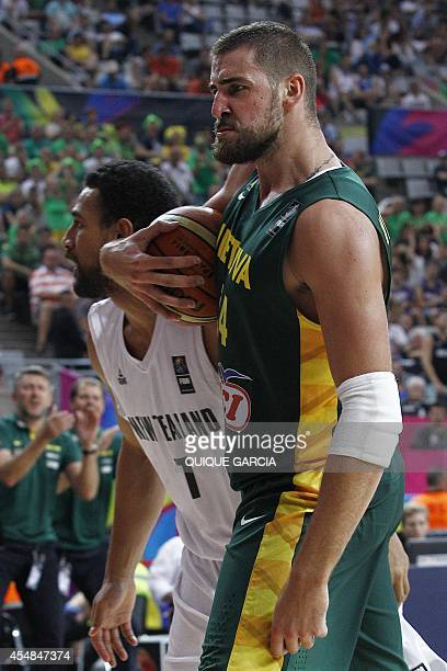 Lithuania's centre Jonas Valanciunas reacts during the 2014 FIBA World basketball championships round of 16 match New Zealand vs Lithuania at the...