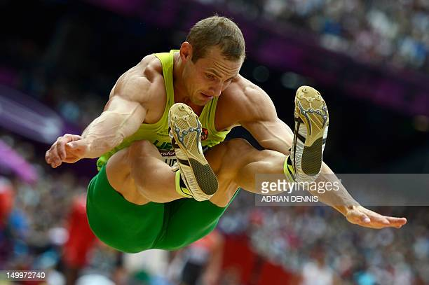 Lithuania's Darius Drauvila competes in the men's decathlon long jump qualifications at the athletics event of the London 2012 Olympic Games on...