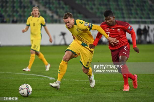Lithuania's defender Vytas Gaspuitis and Switzerland's forward Breel Embolo vie for the ball during the FIFA World Cup Qatar 2022 Group C...