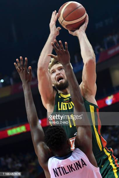 Lithuania's Domantas Sabonis takes a shot as France's Frank Ntilikina tries to block during the Basketball World Cup Group L second round game...