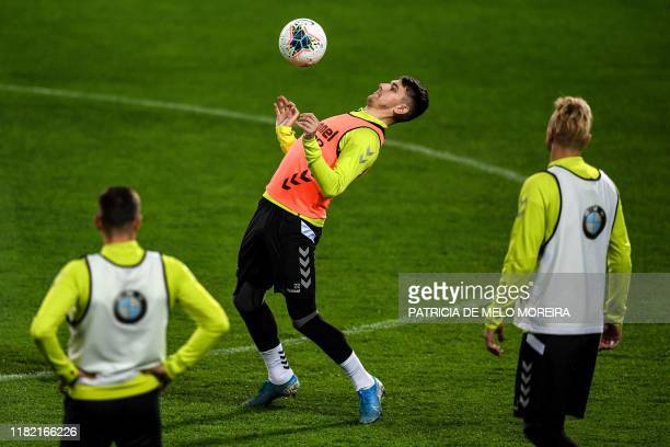 Lithuania's forward Fiodor Cernych controls the ball during a training session at the Algarve stadium in Faro on November 13 on the eve of the Euro...