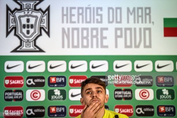 Lithuania's forward Fiodor Cernych gestures during a press conference at the Algarve stadium in Faro on November 13 on the eve of the Euro 2020 Group...