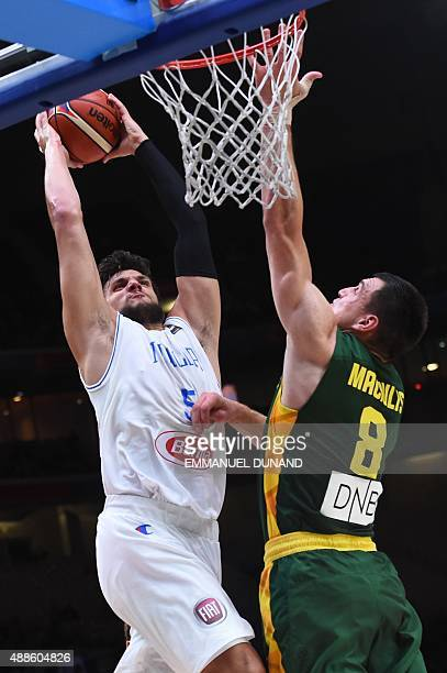 Lithuania's forward Jonas Maciulis defends against Italy's small forward Alessandro Gentile during the round of 8 basketball match between Italy and...