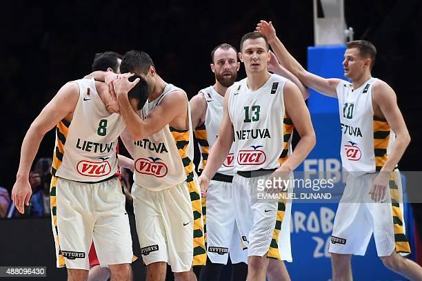 Lithuania's forward Jonas Maciulis Lithuania's point guard Mantas Kalnietis and Lithuania's power forward Paulius Jankunas react after Lithuania...