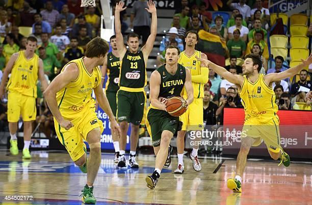 Lithuania's forward Martynas Pocius tries to pass next to Australia's guard Matthew Dellavedova and Australia's guard Brad Newley during the 2014...