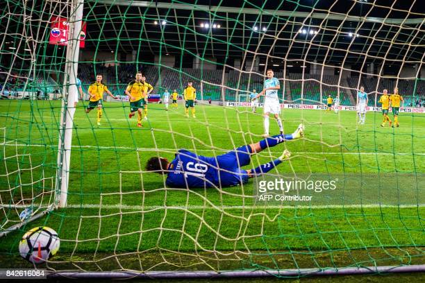 Lithuania's goalkeeper Ernestas Setkus fails to catch a second penalty scored by Slovenia's Josip Ilicic during the FIFA World Cup 2018 qualification...