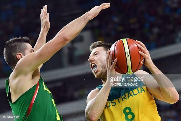 Lithuania's guard Mantas Kalnietis defends against Australia's guard Matthew Dellavedova during a Men's quarterfinal basketball match between...