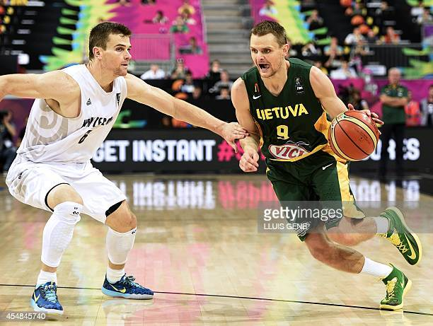 Lithuania's guard Renaldas Seibutis vies with New Zealand's guard Corey Webster during the 2014 FIBA World basketball championships round of 16 match...