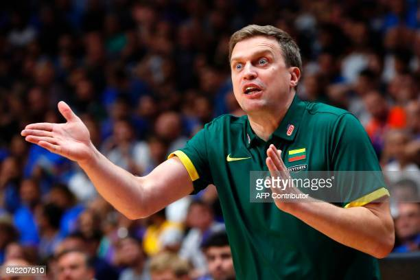 Lithuania's head coach Dainius Adomaitis gives instructions to his players during the FIBA EuroBasket championship basketball match between Italy and...