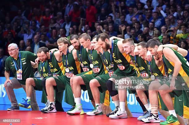 Lithuania's head coach Jonas Kazlauskas Lithuania's guard Lukas Lekavicius Lithuania's shooting guard Arturas Milaknis Lithuania's forward Mindaugas...