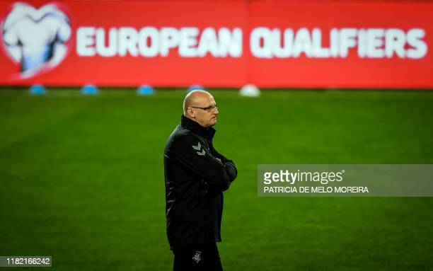 Lithuania's head coach Valdas Urbonas attends a training session at the Algarve stadium in Faro on November 13 on the eve of the Euro 2020 Group B...
