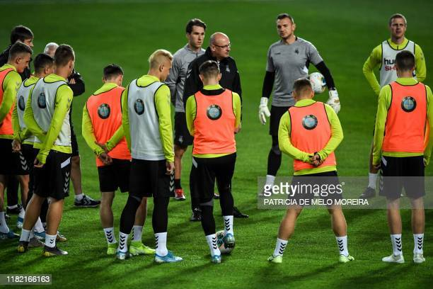 Lithuania's head coach Valdas Urbonas gives instructions to his players during a training session at the Algarve stadium in Faro on November 13 on...