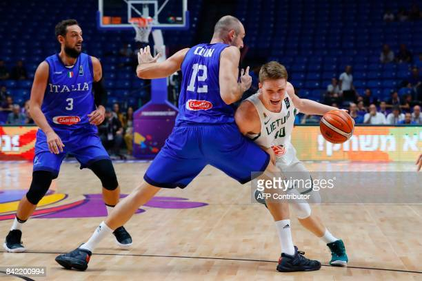 Lithuania's Marius Grigonis vies for the ball with Italy's Marco Cusin during the FIBA EuroBasket championship basketball match between Italy and...