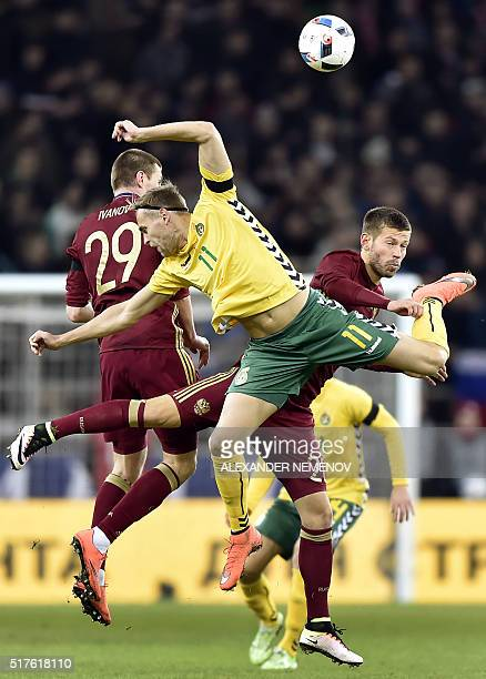 TOPSHOT Lithuania's midfielder Arturas Zulpa vies with Russia's forward Fedor Smolov and midfielder Oleg Ivanov during their friendly football match...
