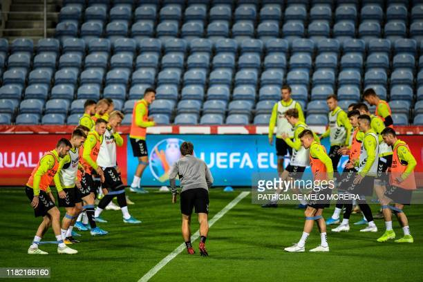 Lithuania's players attend a training session at the Algarve stadium in Faro on November 13 on the eve of the Euro 2020 Group B football...