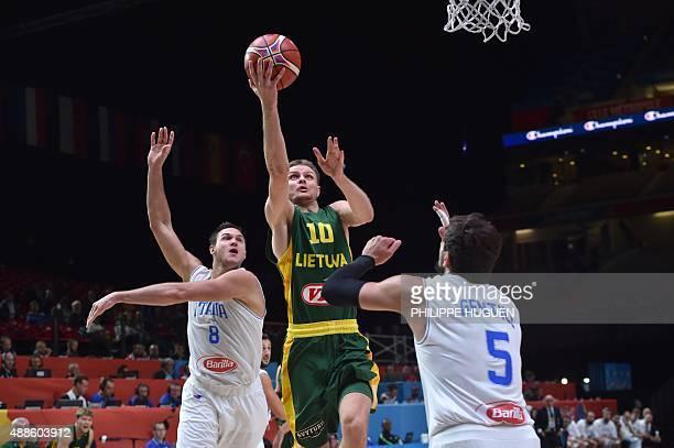 Lithuania's point guard Mantas Kalnietis goes to the basket despite Italy's small forward Danilo Gallinari and Italy's small forward Alessandro...