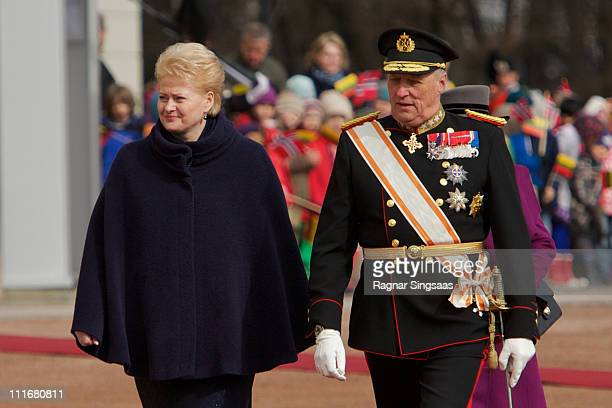 Lithuania's president Dalia Grybauskaite and King Harald V of Norway attend the official welcoming ceremony at the Royal Palace on the first day of...