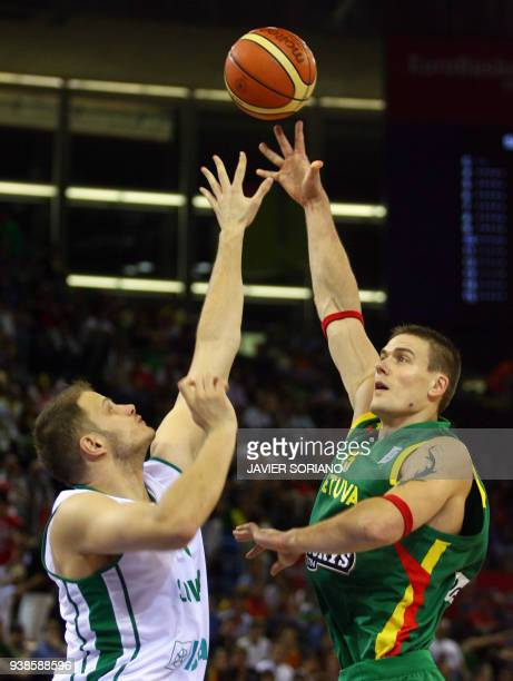 Lithuania's Robertas Javtokas jumps for the ball against Slovenia's Radoslav Nesterovic during a Group F qualifying round match of the European...