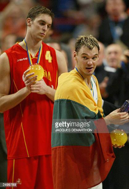 Lithuania's Sarunas Jasikevicius holds his trophy for most valuable player with Spain's Pau Gasol with his medal for best scorer 14 September 2003...