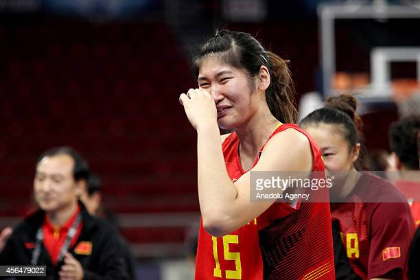 Liting Zhang of China sheds tears of joy after winning the elimination playoff match during 2014 FIBA World Championship For Women between Belarus...