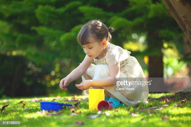 litle girl playing in yard - carol cook stock pictures, royalty-free photos & images