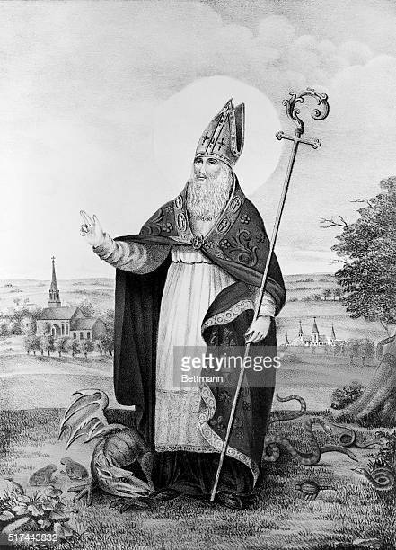 Litograph of St Patrick the Apostle of Ireland St Patrick is dressed in the papal costume complete with crozier A dragon is curled around his feet...