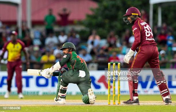 Liton Das of Bangladesh hits the first ball for 4 during the 3rd and final T20i match between West Indies and Bangladesh at Central Broward Regional...
