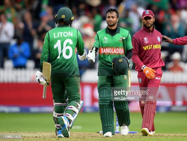Liton Das of Bangladesh shakes hands with with Shakib Al Hasan of Bangladesh bats during the Group Stage match of the ICC Cricket World Cup 2019...