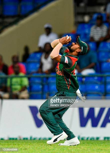 Liton Das of Bangladesh takes the catch to dismiss Evin Lewis of West Indies during the 1st T20i match between West Indies and Bangladesh at Warner...