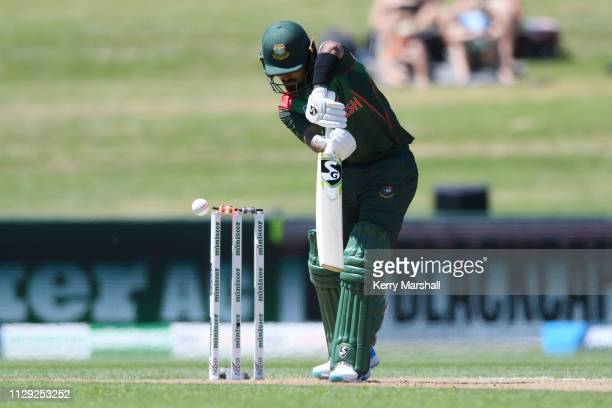 Liton Kumer Das of Bangladesh is bowled during Game 1 of the One Day International series between New Zealand v Bangladesh at McLean Park on February...