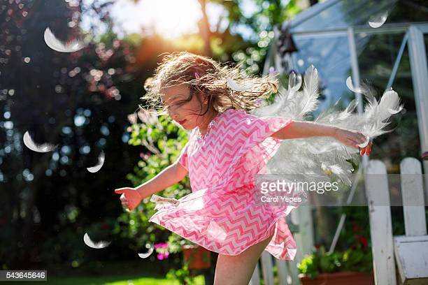 littñe girl spinning outdoors