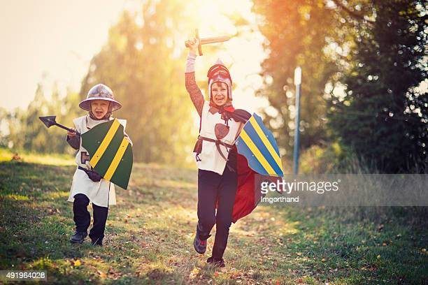 litte knights charging - warrior person stock photos and pictures