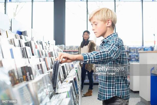 Littel boy looking for a new DVD